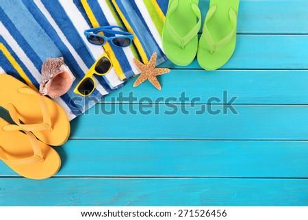Summer sunbathing beach background, sunglasses, flip flops, copy space - stock photo