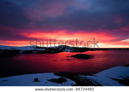 Summer  sunset in Antarctica.  Beautiful winter background. - stock photo