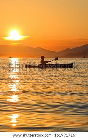 Summer sunset kayaking in Montenegro - stock photo
