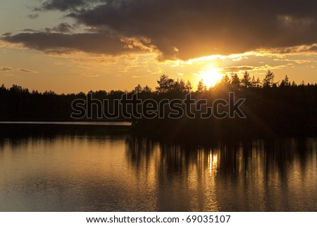 Summer sunset on forest lake, Karelia, Russia - stock photo