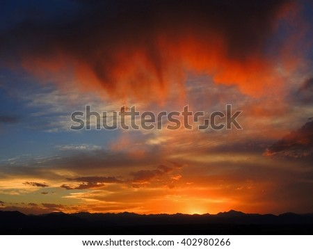 Summer sunset over the Rocky Mountains of colorado, as seen from Broomfield  - stock photo