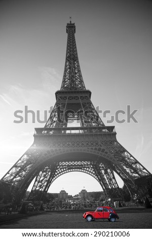 summer sunset vintage red car stands on the Champ de Mars Eiffel Tower. black and white photo - stock photo