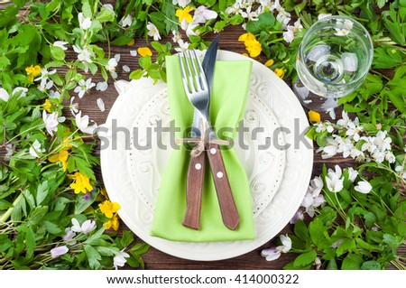 Summer table settings with flowers, cutlery and wineglass. Floral wedding table settings in rustic style. Holidays background. Top view - stock photo
