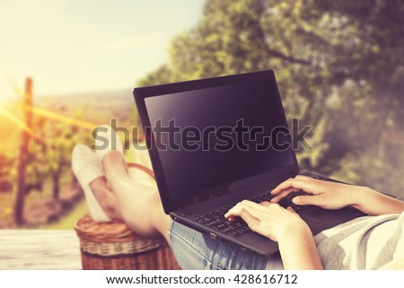 summer time in garden and black laptop