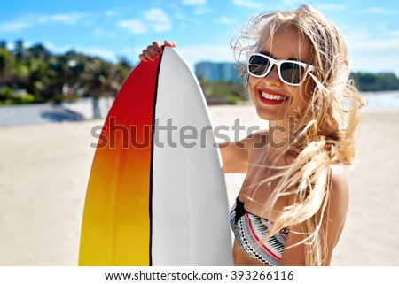 Summer Travel Beach Vacation. Close Up Of Healthy Happy Beautiful Sexy Woman In Sunglasses With Surfboard Having Fun By Sea. Active Lifestyle. Leisure Sporting Activity. Water Sports. Summertime Relax - stock photo