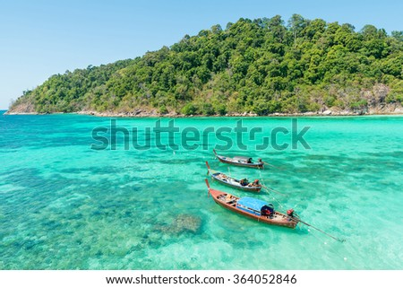 Summer, Travel, Vacation and Holiday concept - Tropical beach, longtail boats, Andaman Sea in Phuket, Thailand