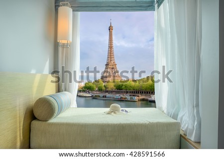 Summer, Travel, Vacation and Holiday in Paris ,France. Beautiful Eiffel tower view at window in resort near Seine river, Paris ,France.