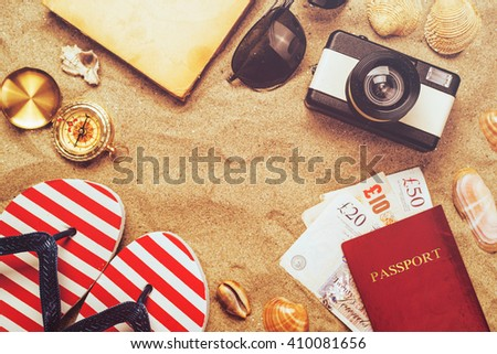 Summer vacation accessories on tropical sandy ocean beach, holidays abroad - summertime lifestyle objects and Great Britain pounds in flat lay top view arrangement in warm sand. - stock photo