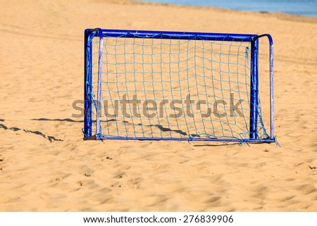 Summer vacation, active lifestyle concept. Football gate on sandy beach soccer goal