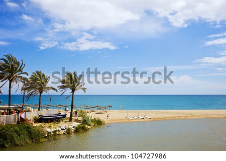 Summer vacation beach and sea scenery on Costa del Sol in Spain, located between Marbella and Puerto Banus, waters of Green River (Spanish: Rio Verde) and Mediterranean Sea. - stock photo