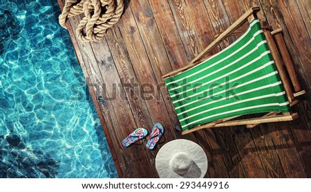 Summer vacation. Blue sandals by swimming pool. Blue sea surface with waves, texture water. Flat mock up for design. - stock photo