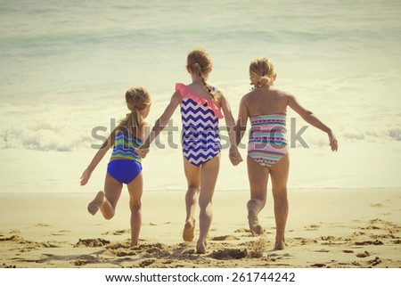 Summer Vacation fun at the Beach for three little girls - stock photo
