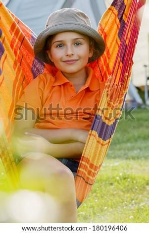 Summer vacation, hammock - lovely girl in a hammock - stock photo