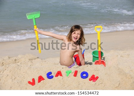 Summer vacation on the beach: happy child playing