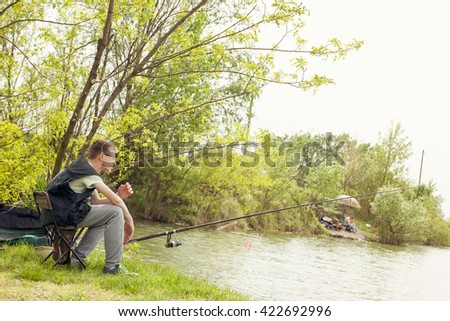 Summer vacation - Photo of boy fishing on the river. - stock photo