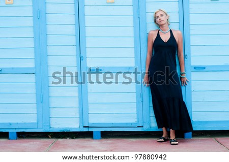 Summer vacation - portrait of beautiful woman in beach resort
