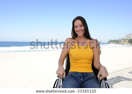 summer vacation: woman in wheelchair  enjoying outdoors beach - stock photo
