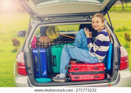 Summer vacation, young girl ready to travel for summer holiday - stock photo