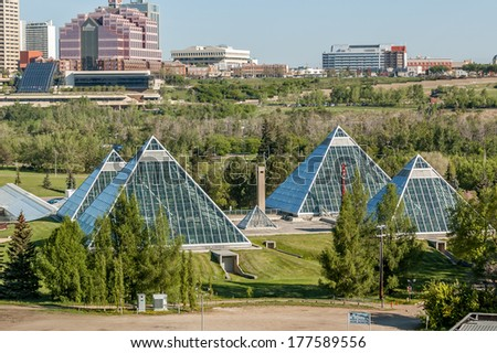 Summer view of a modern building (muttart conservatory) and its reflections, Edmonton, Alberta, Canada - stock photo