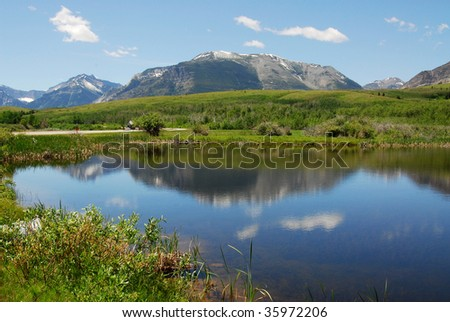 Summer view of mountains and lake in glacier national park, montana, usa - stock photo