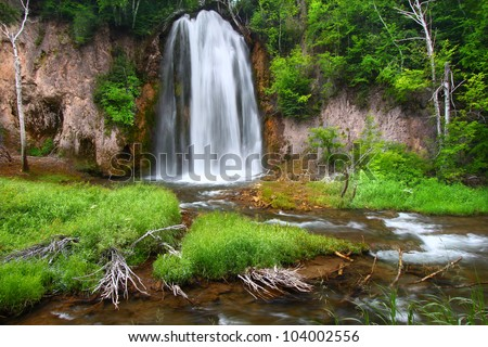 Summer view of Spearfish Falls in the Black Hills National Forest of South Dakota - stock photo
