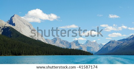 Summer view of the blue maligne lake and surrounding mountains in jasper national park, alberta, canada - stock photo