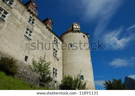 Summer view of the wall and tower of the Castle at Gruyeres Switzerland.