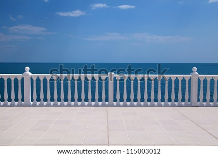 Summer view with classic white balustrade and empty terrace overlooking the sea (Italy) - stock photo