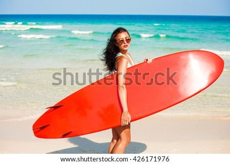 Summer Water Sports. Beautiful Fit Smiling Surfer Woman With Sexy Body In Bikini Posing With Surf Board On Beach. Healthy Active Lifestyle. Leisure Sport. Hobby, Wellness - stock photo