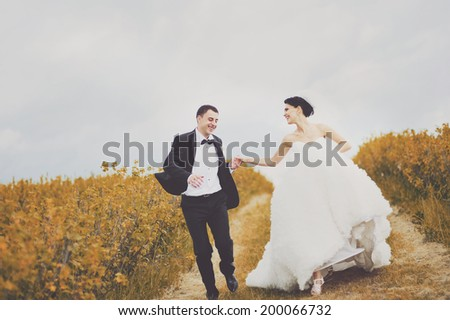 Summer wedding. Young newlywed couple in garden. Symbol of togetherness. - stock photo