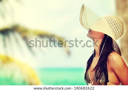 Summer woman in swimsuit and hat - stock photo
