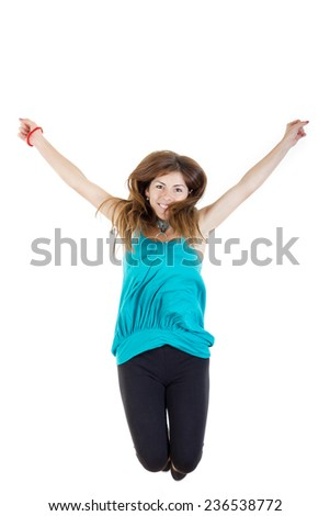 Summer woman or girl jumping with arms up of joy excited isolated on white background ,  casual woman jumping happy and free in full body. Beautiful Caucasian model smiling. - stock photo