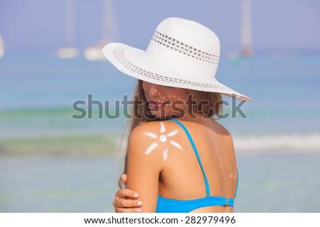summer woman sun tan skin care concept - stock photo