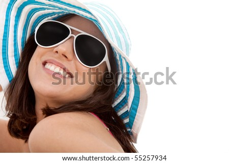 Summer woman wearing a hat and sunglasses  smiling - isolated
