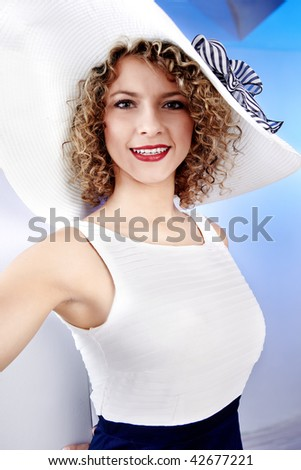 Summer woman wearing white hat - stock photo
