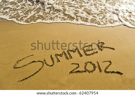 Summer 2012, written in the sand! - stock photo