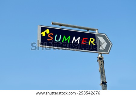 Summer written on blue road sign with arrow