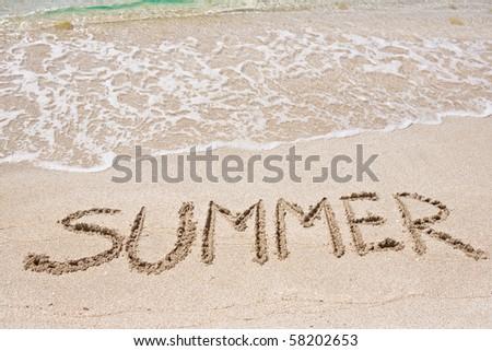 Summer written on the sand - stock photo