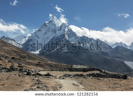 Summer yak farm Dusa against the peak Ama Dablam - Nepal, Himalayas - stock photo