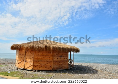 Summerhouse with thatched roof on the Black Sea coast - stock photo
