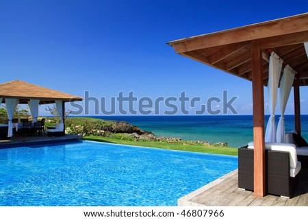 Summerhouses with swimming pool near Atlantic ocean - stock photo