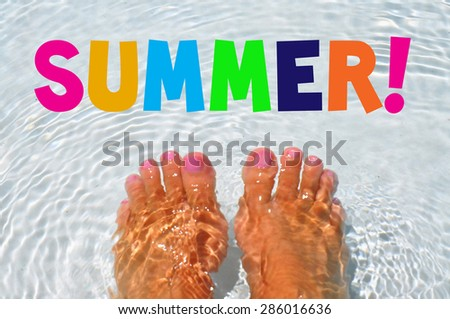 Summertime concept. Pair of feet soaking in pool water