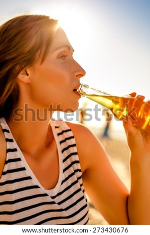 summertime drink blurred background outdoors - stock photo