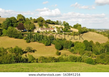 Summertime Landscape View of Fields and Houses in the Avon Valley on the Wiltshire Somerset Borader in England - stock photo