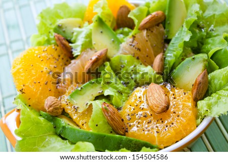 Summery Citrus Salad with almonds and lemon poppy seed dressing - stock photo