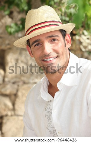 Summery man in a straw hat - stock photo