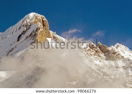 Summit of jungfrau - top of Europe in Grindelwald ski area. Switzerland. There are a blue sky and clouds