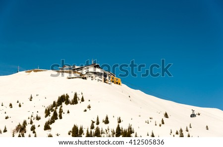 summit station of a cable car in the austrian alps - stock photo