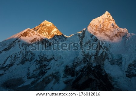 Summits of Mt. Everest and Nuptse at Sunset, Khumjung, Solu Khumbu, Nepal. - stock photo
