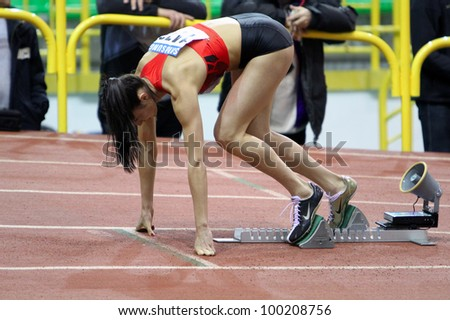 SUMY, UKRAINE - FEB.16: Bryzgina Elyzaveta - European Champion wins second place on the 400 meters dash during the Ukrainian Track and Field Championships on February 16, 2012 in Sumy, Ukraine. - stock photo